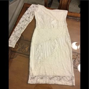 White/ cream colored lace design ladies dress.